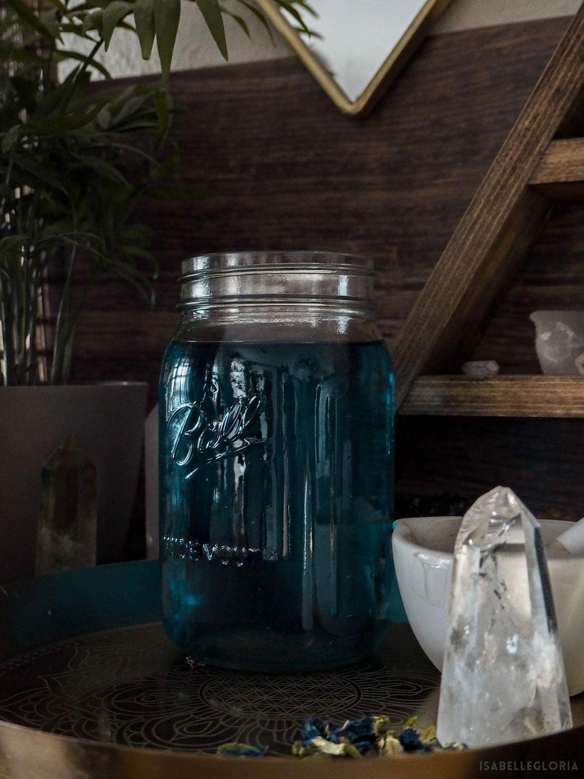 blue tea mason jar on desk with crystal points